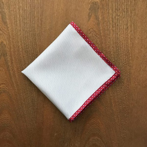 White pocket square with light blue lines with red flower border